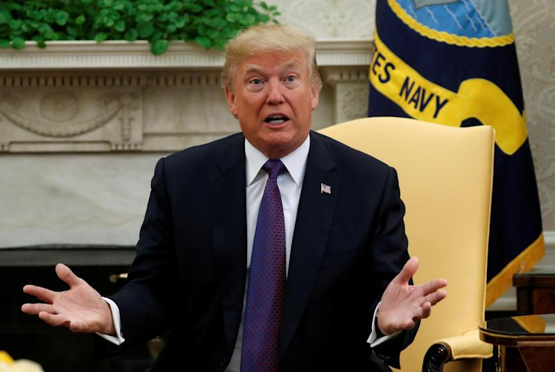 """""""All I can say is it's totally fake news. It's just fake. It's fake. It's made-up stuff, and it's disgraceful, what happens, but that happens in the world of politics,"""" Donald Trump said in October: Reuters"""