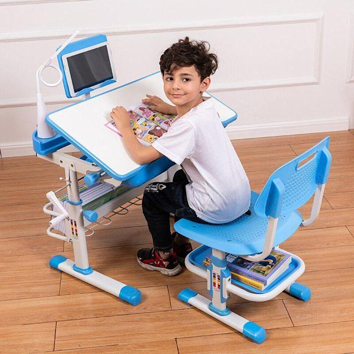 """<p><strong>Zoomie Kids</strong></p><p>wayfair.com</p><p><strong>$103.99</strong></p><p><a href=""""https://go.redirectingat.com?id=74968X1596630&url=https%3A%2F%2Fwww.wayfair.com%2Fbaby-kids%2Fpdp%2Fzoomie-kids-childrens-writing-desk-multifunctional-lifting-home-primary-school-desk-w005508856.html&sref=https%3A%2F%2Fwww.bestproducts.com%2Fparenting%2Fg37696840%2Fgifts-for-5-year-old-boys%2F"""" rel=""""nofollow noopener"""" target=""""_blank"""" data-ylk=""""slk:Shop Now"""" class=""""link rapid-noclick-resp"""">Shop Now</a></p><p>Now that kindergarten is here (or just around the corner), your little scholar will need a workspace of his own, and this little desk is just the thing. This adjustable-height desk and chair come with a lamp, storage space, and nooks and crannies for everything from school supplies to a tablet.</p>"""