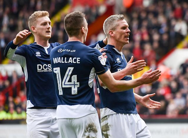 "Soccer Football - Championship - Sheffield United vs Millwall - Bramall Lane, Sheffield, Britain - April 14, 2018 Millwall's Steve Morison celebrates with team mates after scoring their first goal Action Images/Paul Burrows EDITORIAL USE ONLY. No use with unauthorized audio, video, data, fixture lists, club/league logos or ""live"" services. Online in-match use limited to 75 images, no video emulation. No use in betting, games or single club/league/player publications. Please contact your account representative for further details."