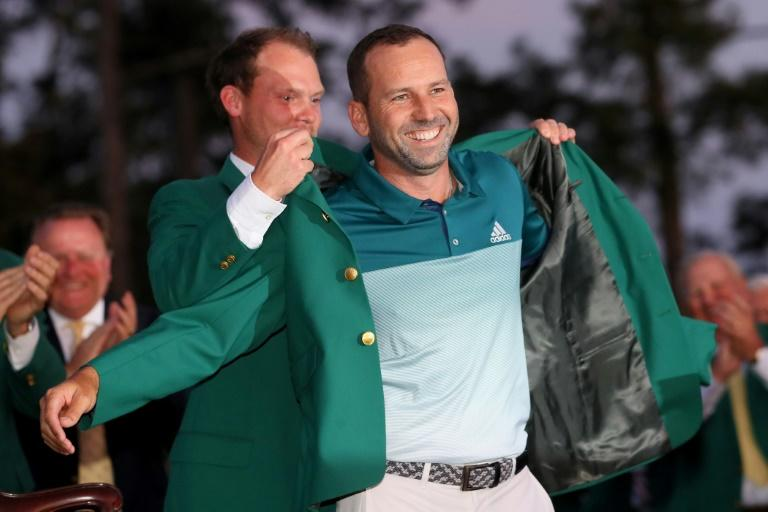 Danny Willett of England presents Sergio Garcia of Spain with the green jacket after Garcia won in a playoff during the final round of the 2017 Masters tournament, at Augusta National Golf Club in Georgia, on April 9