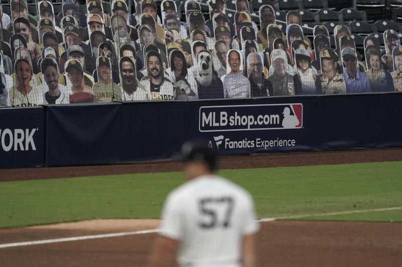 Cutouts of fans fill seats during Game 3 of a baseball American League Division Series between the Tampa Bay Rays and the New York Yankees, Wednesday, Oct. 7, 2020, in San Diego. (AP Photo/Jae C. Hong)