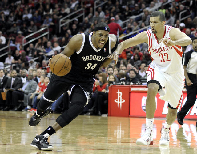 Brooklyn Nets' Paul Pierce (34) drives the ball past Houston Rockets' Francisco Garcia (32) in the first half of an NBA basketball game on Friday, Nov. 29, 2013, in Houston. (AP Photo/Pat Sullivan)