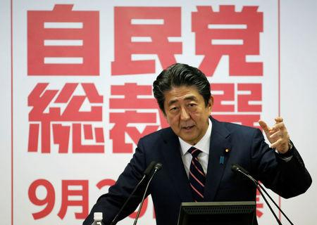 Japan's PM Abe, who is also the ruling LDP, attends a news conference after he won the ruling party leadership vote at the party's headquarters in Tokyo
