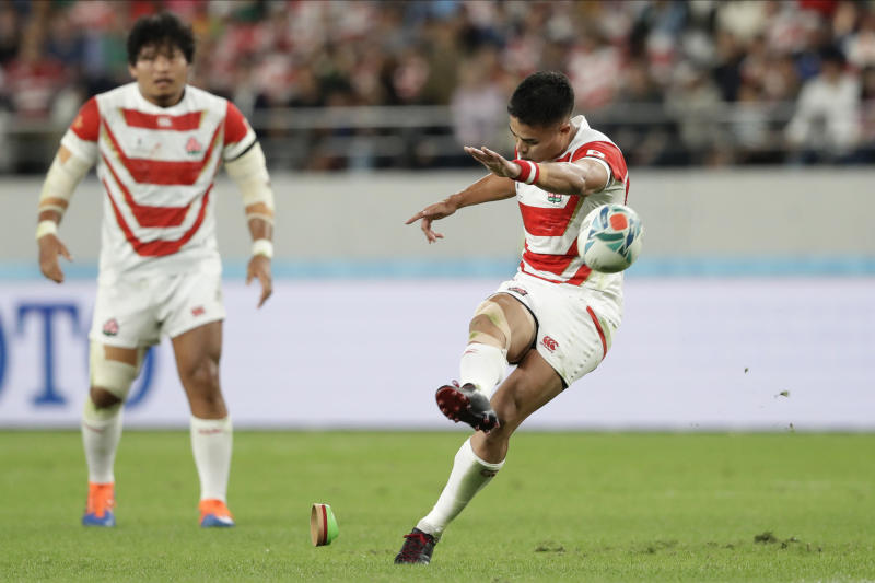 Japan's Yu Tamura kicks a penalty goal during the Rugby World Cup quarterfinal match at Tokyo Stadium between Japan and South Africa in Tokyo, Japan, Sunday, Oct. 20, 2019. (AP Photo/Mark Baker)