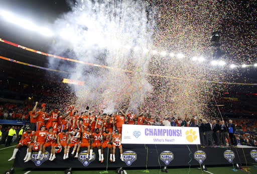 Clemson players celebrate their 30-3 win against Notre Dame in the NCAA Cotton Bowl semi-final playoff football game, Saturday, Dec. 29, 2018, in Arlington, Texas. Clemson won 30-3. (AP Photo/Michael Ainsworth)