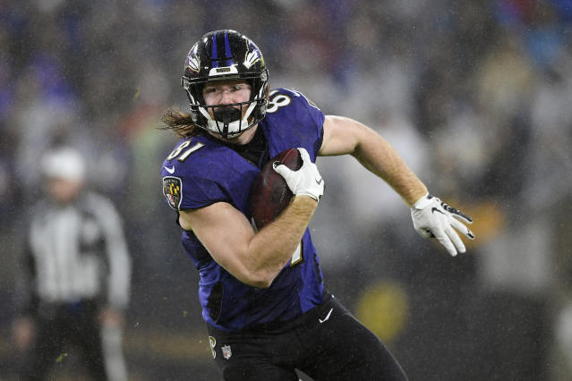 FILE - In this Dec. 29, 2019, file photo, Baltimore Ravens tight end Hayden Hurst (81) runs with the ball during the first half of an NFL football game against the Pittsburgh Steelers, in Baltimore. The Atlanta Falcons are expected to announce a trade with Baltimore for tight end Hayden Hurst. The Falcons, who are cutting running back Devonta Freeman and cornerback Desmond Trufant, among others, in cost-cutting moves, are hoping Hurst will replace Austin Hooper, who signed with Cleveland as a free agent. (AP Photo/Nick Wass, File)