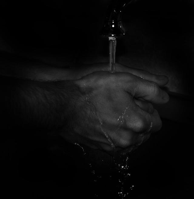 Water running from tap at night.