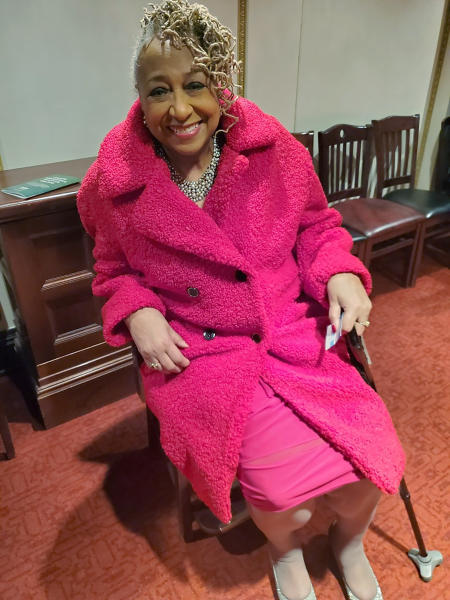 In this March 7, 2020, photo provided by Marsha Battle Philpot, Brenda Perryman, sits at a Detroit Symphony Orchestra performance at the Max M. and Marjorie S. Fisher Music Center, in Detroit. As the coronavirus tightens its grip across the country, it is cutting a particularly devastating swath through an already vulnerable population, black Americans. In Detroit, the deaths include Gloria Smith, a fixture at the city's African World Festival, who died within a week of her husband, and educator and playwright Perryman. (Marsha Battle Philpot, aka Marsha Music via AP)