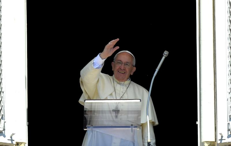 Pope Francis delivers a speech from the window of his apartment during his Sunday Angelus prayer in Saint Peter's Square at the Vatican on September 7, 2014