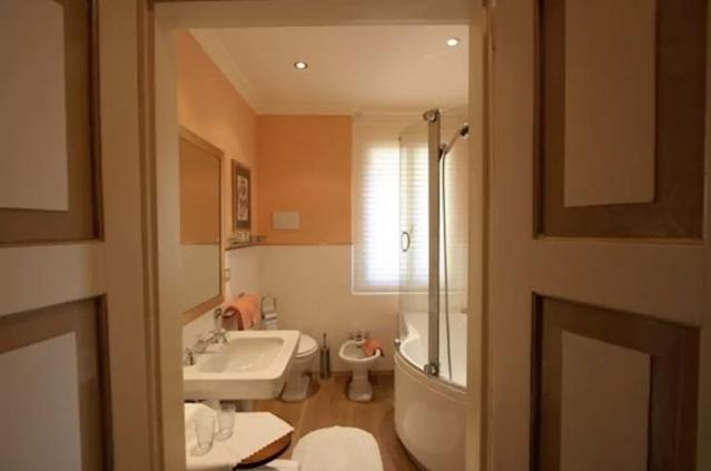 <p>They are separated by a large bathroom with a shower, tub and bidet. </p>