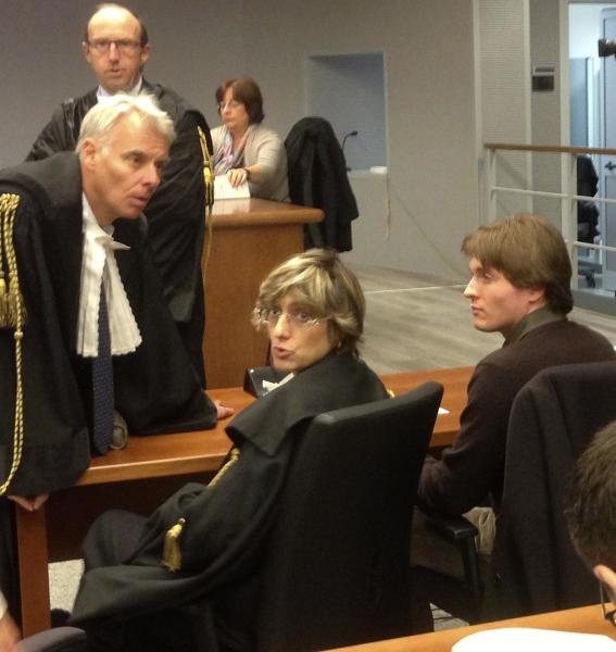 FILE - In this Wednesday, Nov. 6, 2013 file photo taken with a mobile phone, former American exchange student Amanda Knox's Italian ex-boyfriend Raffaele Sollecito, right, sits with his lawyer Giulia Bongiorno, center, as Knox's lawyer Carlo Dalla Vedova speaks to them ahead of a hearing in Sollecito and Knox's trial at an appeals court in Florence, Italy. Knox spent four years in jail in Italy, from her arrest to her conviction in her first murder trial through her successful appeal. She's now facing a second appeals trial, along with Sollecito. (AP Photo/Patricia Thomas, File)