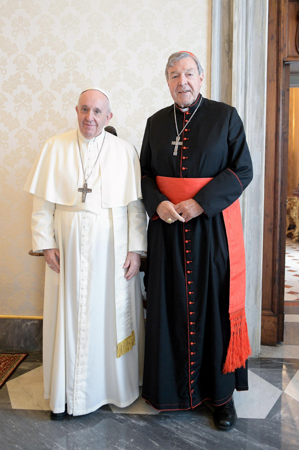 Pope Francis, left, stands next to Cardinal George Pell on the occasion of their private meeting at the Vatican, Monday, Oct. 12, 2020. The Pope warmly welcomed Cardinal for a private audience in the Apostolic Palace after the cardinal's sex abuse conviction and acquittal in Australia. (Vatican News via AP)