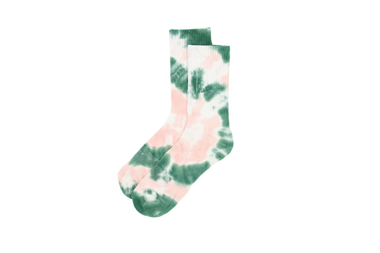 "$16, Need Supply. <a href=""https://needsupply.com/tie-dye-sock-in-green-pink/MCA100967.html?lang=en_US"">Get it now!</a>"
