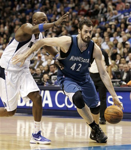 Minnesota Timberwolves' Kevin Love (42) drives past Dallas Mavericks' Lamar Odom on his way to the basket in the first half of an NBA basketball game, Wednesday, Jan. 25, 2012, in Dallas. (AP Photo/Tony Gutierrez)