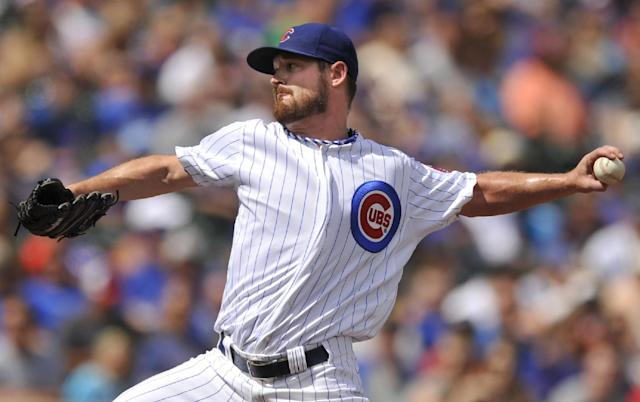Chicago Cubs starter Travis Wood delivers a pitch during the first inning of a baseball game against the Miami Marlins in Chicago, Monday, Sept. 2, 2013. (AP Photo/Paul Beaty)