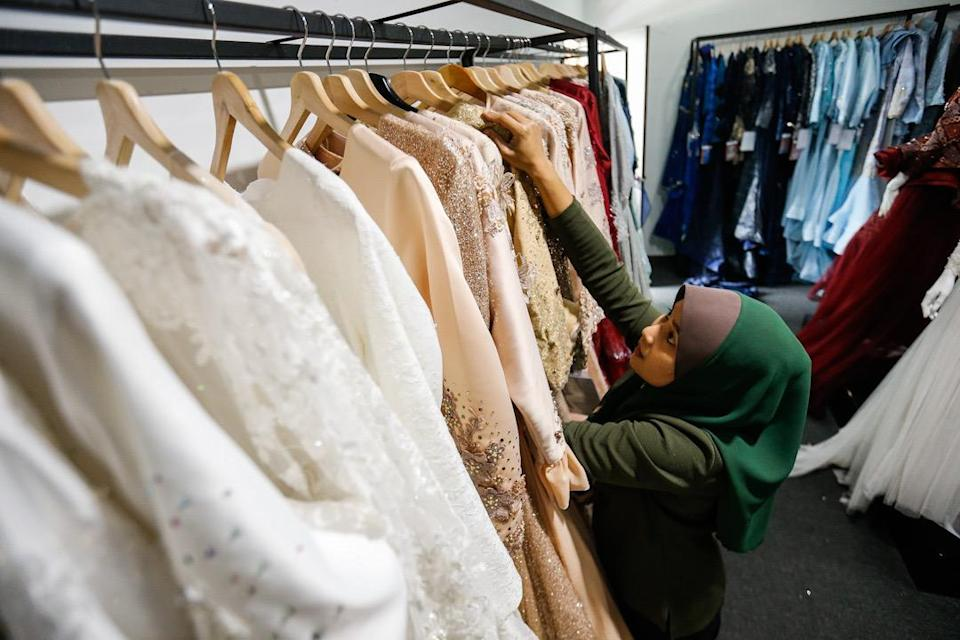 Solemnisation of marriages in mosques will be allowed in MCO states. A worker is pictured at the Kaled Ross Weddings and Events bridal boutiquein Balik Pulau on June 29, 2020 as it prepares to welcome back customer on July 1. — Picture by Sayuti Zainudin