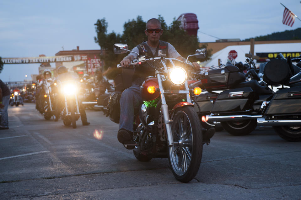 STURGIS, SD - AUGUST 3:  A biker rides downtown on the first day of the annual Sturgis Motorcycle Rally August 3, 2015 in Sturgis, South Dakota.  This year marks the 75th anniversary of the rally, with crowds of up to 1.2 million people expected to visit.    (Photo by Andrew Cullen/Getty Images)