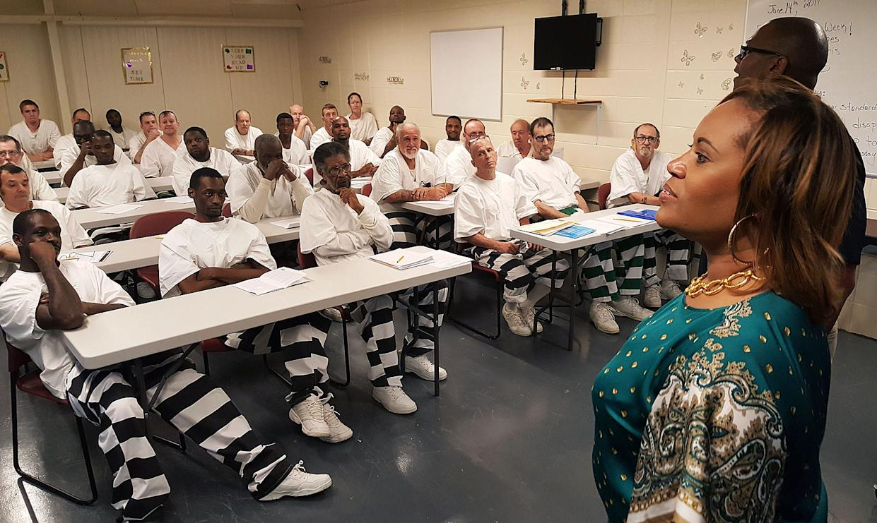 State Department of Corrections Deputy Commissioner of Institutions Jerry Williams, upper right, helps teach inmates at South Mississippi Correctional Institution in Leakesville about job interviewing strategies while Corrections Commissioner Pelicia Hall observes. The class is part of Hall's plan big vision to turn the state's prisons into places that teach and train offenders.