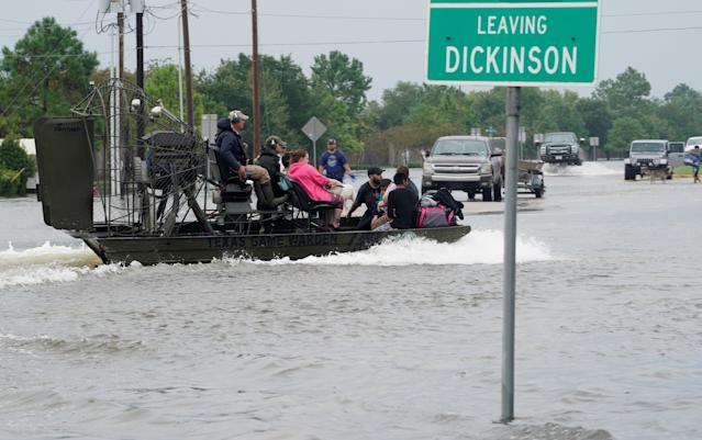 People are rescued by airboat in Dickinson, Texas, on Sunday. (Photo: Rick Wilking/Reuters)