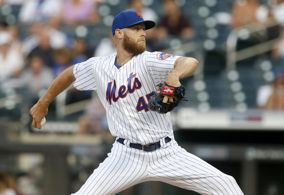 NEW YORK, NEW YORK - JULY 26:   Zack Wheeler #45 of the New York Mets pitches during the first inning against the Pittsburgh Pirates at Citi Field on July 26, 2019 in New York City. (Photo by Jim McIsaac/Getty Images)