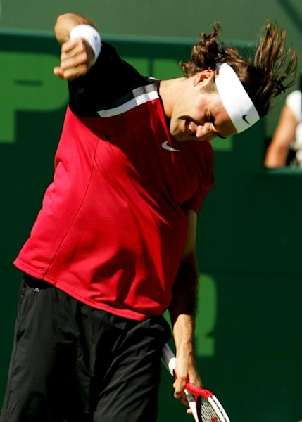 Roger Federer of Switzerland celebrates defeating Rafael Nadal of Spain in the men's final of the NASDAQ-100 Open at the Crandon Park Tennis Center in Key Biscayne, Florida on April 3, 2005
