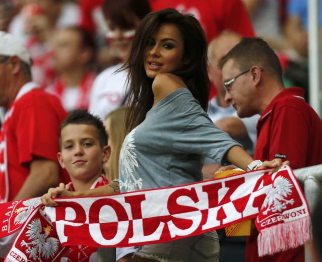 A fan of Poland makes a victory sign before the start of their Group A Euro 2012 soccer match against Czech Republic at the City Stadium in Wroclaw, June 16, 2012. REUTERS/Dominic Ebenbichler (POLAND - Tags: SPORT SOCCER)