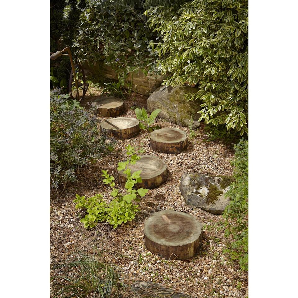 quirky path made with tree trunk stepping stones