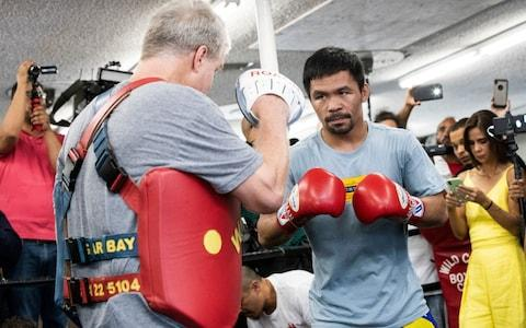 <span>Pacquiao training ahead of his fight with Keith Thurman</span> <span>Credit: REX </span>
