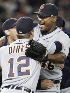 Tigers closer Jose Valverde is mobbed by teammates after striking out Alex Rodriguez to record the final out of the ALDS in New York