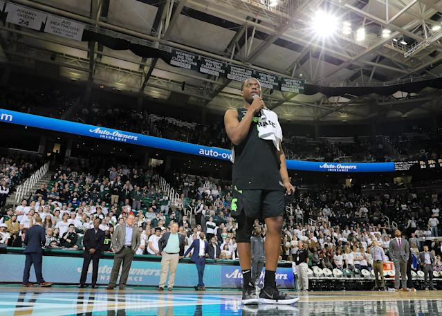 """After leading the Spartans past Charleston Southern on Monday, <a class=""""link rapid-noclick-resp"""" href=""""/ncaab/players/137368/"""" data-ylk=""""slk:Cassius Winston"""">Cassius Winston</a> stopped to thank Michigan State fans after his emotional week. (Rey Del Rio/Getty Images)"""