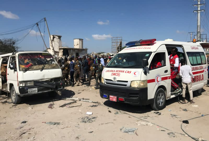 An ambulance leaves from the scene of a car bomb explosion at a checkpoint in Mogadishu
