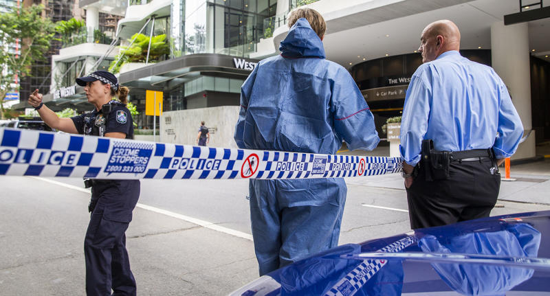 The forensic scene where police shot and killed a man outside the Westin Hotel on Mary Street in central Brisbane, Sunday, February 23, 2020.(AAP Image/Glenn Hunt) NO ARCHIVING