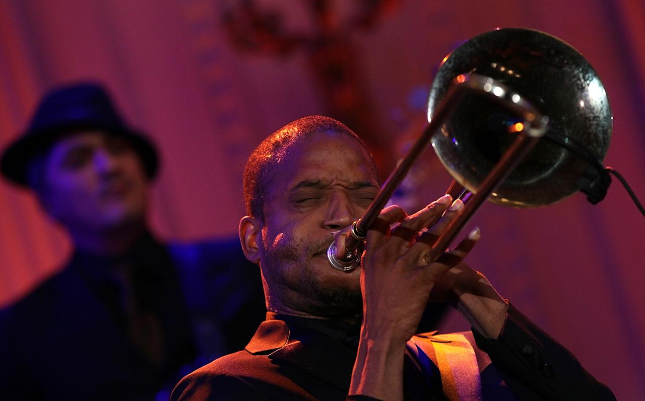 "WASHINGTON, DC - FEBRUARY 21:  Troy ""Trombone Shorty"" Andrews performs with an all-star cast at a White House event titled In Performance at the White House: Red, White and Blues February 21, 2012 in Washington, DC.  As part of the In Perfomance series, music legends and contemporary major artists have been invited to perform at  the White House for a celebration of Blues music and in recognition of Black History Month. The program featured performances by B.B. King, Jeff Beck, Gary Clark, Jr., Shemekia Copeland, Buddy Guy, Warren Haynes, Mick Jagger, Keb Mo, Susan Tedeschi and Derek Trucks, with Taraji P. Henson as the program host and Booker T. Jones as music director and band leader.  (Photo by Win McNamee/Getty Images)"