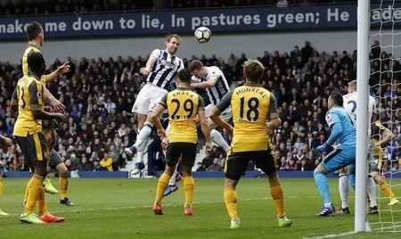 Britain Football Soccer - West Bromwich Albion v Arsenal - Premier League - The Hawthorns - 18/3/17 West Bromwich Albion's Craig Dawson scores their third goal Reuters / Darren Staples Livepic
