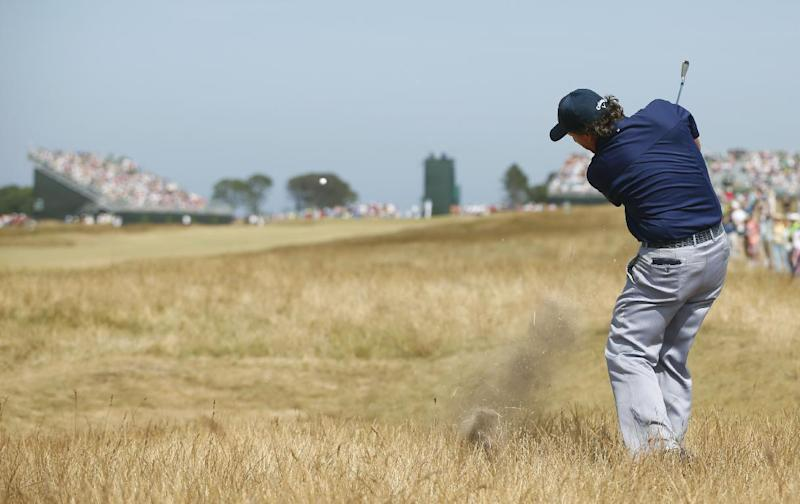 Phil Mickelson of the United States plays a shot on the 5th hole during the third round of the British Open Golf Championship at Muirfield, Scotland, Saturday July 20, 2013. (AP Photo/Peter Morrison)
