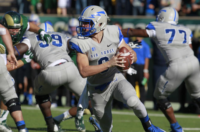 Air Force quarterback Nate Romine scrambles under pressure from Colorado State in the second quarter of an NCAA football game in Fort Collins, Colo., on Saturday, Nov. 30, 2013. (AP Photo/David Zalubowski)
