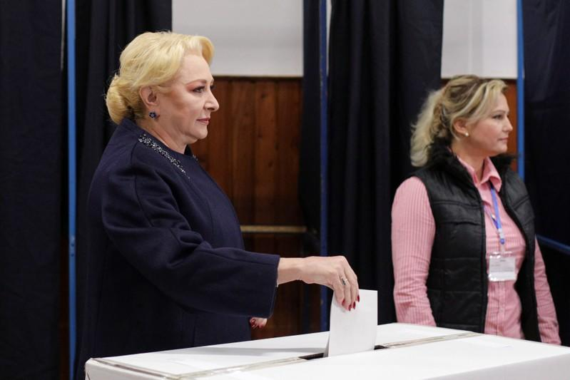 Former Romanian Prime Minister and presidential candidate Viorica Dancila casts her ballot in the second round of a presidential election