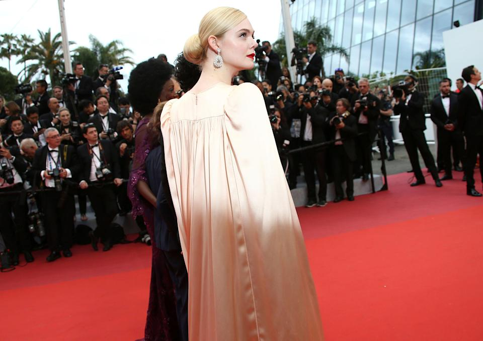 Jury member Elle Fanning poses for photographers upon arrival at the opening ceremony and the premiere of the film 'The Dead Don't Die' at the 72nd international film festival, Cannes, southern France, Tuesday, May 14, 2019. (Photo by Joel C Ryan/Invision/AP)