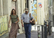 """This image released by Focus Features shows Camille Cottin, left, and Matt Damon in a scene from """"Stillwater."""" (Jessica Forde/Focus Features via AP)"""