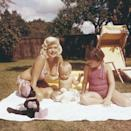<p>Jayne catches some rays in her garden with her son Mickey and daughter Jayne Marie in 1959. The Hollywood actress had five children, including daughter Mariska Hargitay, before her death in 1967. </p>