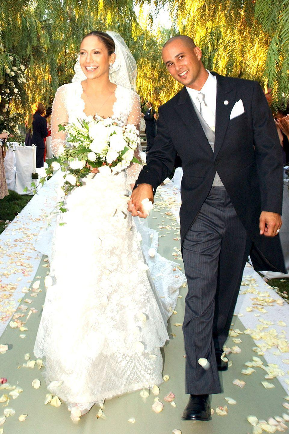 <p>J. Lo's been hitched three times, but her best dress appeared at her nuptials to former backup dancer Cris Judd. The off-white silk and Chantilly lace gown with a plunging front and back was designed by Valentino.</p>