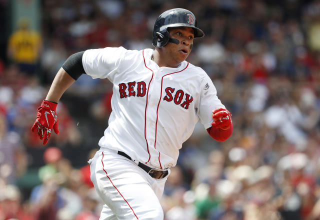 Boston Red Sox's Rafael Devers runs out an RBI-double against the Seattle Mariners during the fifth inning of a baseball game at Fenway Park in Boston,Sunday, June 24, 2018. (AP Photo/Winslow Townson)