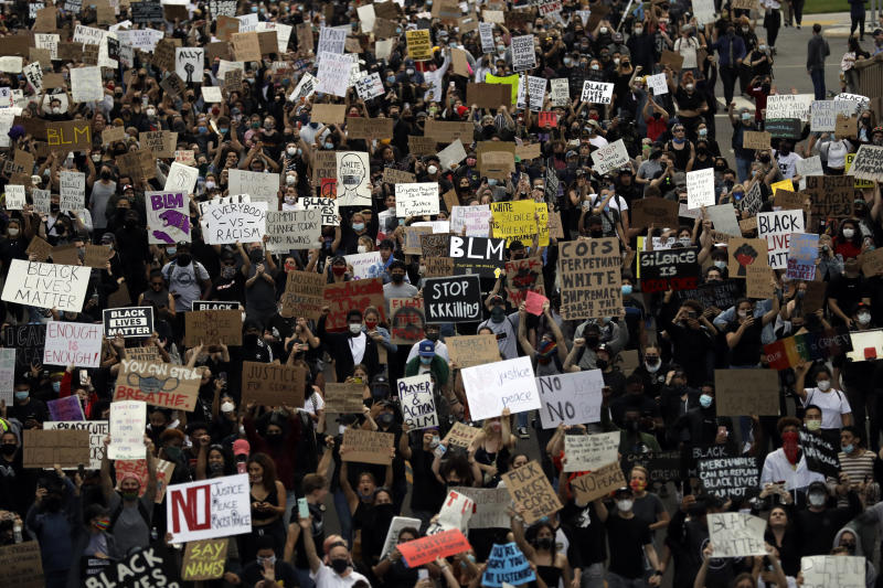 Protesters march Thursday, June 4, 2020, in San Diego. Protests continue to be held in U.S. cities, sparked by the death of George Floyd, a black man who died after being restrained by Minneapolis police officers on May 25. (AP Photo/Gregory Bull)