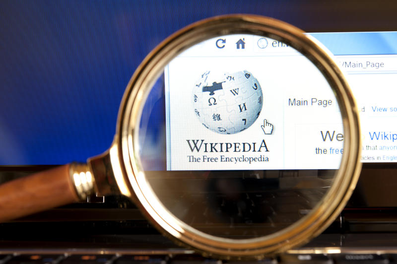 """Izmir, Turkey - June 12, 2012: Close up to Wikipedia website through a magnifying glass on the laptop. Wikipedia is the most popular encyclopedia on the web."""
