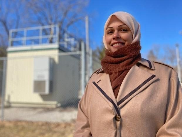 Hind Al-Abadleh, shown in front of an air quality monitoring station in Kitchener, says smoke from wild and forest fires can be a health concern for people in southern Ontario, but it should also spark conversations about the impact climate change has on the intensity and frequency of fires. (Mark Bochsler/CBC - image credit)