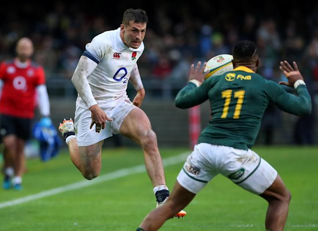 Rugby Union - Third Test International - South Africa v England - Newlands Stadium, Cape Town, South Africa - June 23, 2018. England's Jonny May kicks past South Africa's Amphiwe Dyantyi. REUTERS/Mike Hutchings