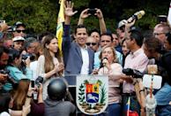 Venezuela's opposition leader Juan Guaido waves to his supporters during a rally with members of the Venezuela's National Assembly regarding an amnesty law project for members of the military, in Caracas, Venezuela, January 26, 2019. REUTERS/Carlos Garcia Rawlins