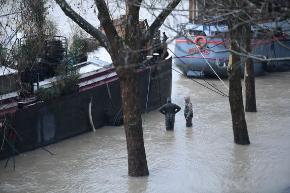 "<img alt=""""/><p>In Paris, the Seine is flooding. </p> <p>After heavy rains, the river's water level hit around 16 feet on Tuesday, a city official told <a rel=""nofollow"" href=""https://www.washingtonpost.com/news/worldviews/wp/2018/01/23/flood-of-the-century-fears-rise-in-paris-along-with-the-seine/?utm_term=.8d559492342d""><em>The Washington Post</em></a>. It could reach 19.5 feet by the end of the week. On a normal day, it's about 6.5 feet. River cruises and the commuter rail line that runs along the Seine have been shut down. It's the worst flooding since 2016, when rising waters forced the Louvre to shut down as museum workers crated works of art and moved them upstairs. </p> <p>The flood emergency level is currently at ""orange,"" the highest warning below ""red."" It's not quite the worst flooding Paris has even seen. Back in 1910, the Seine rose to 28 feet, submerging the City of Lights for two months. </p> <p><img title=""The Seine has turned into a powerful muddy torrent that has submerged parks and footpaths alongside its channel that runs through the French capital, while river boats are no longer able to pass under the city's bridges."" alt=""The Seine has turned into a powerful muddy torrent that has submerged parks and footpaths alongside its channel that runs through the French capital, while river boats are no longer able to pass under the city's bridges.""></p> <p>The Seine has turned into a powerful muddy torrent that has submerged parks and footpaths alongside its channel that runs through the French capital, while river boats are no longer able to pass under the city's bridges.</p><div><p>Image:  LUDOVIC MARIN/AFP/Getty Images</p></div><p><img title=""A man holds his shoes in his hands as he walks through the Seine after it burst its banks in Paris."" alt=""A man holds his shoes in his hands as he walks through the Seine after it burst its banks in Paris.""></p> <p>A man holds his shoes in his hands as he walks through the Seine after it burst its banks in Paris.</p><div><p>Image:  CHRISTOPHE SIMON/AFP/Getty Images</p></div><p><img title=""A tree and street lights on the tip of the flooded Île de la Cité."" alt=""A tree and street lights on the tip of the flooded Île de la Cité.""></p> <p>A tree and street lights on the tip of the flooded Île de la Cité.</p><div><p>Image:  STEPHANE DE SAKUTIN/AFP/Getty Images</p></div><p><img title=""Flood of the river Yerres, in the south of Paris. Montgeron, Crosnes, Yerres and Brunoy are among the towns affected by the flood of this river, a Seine river tributary."" alt=""Flood of the river Yerres, in the south of Paris. Montgeron, Crosnes, Yerres and Brunoy are among the towns affected by the flood of this river, a Seine river tributary.""></p> <p>Flood of the river Yerres, in the south of Paris. Montgeron, Crosnes, Yerres and Brunoy are among the towns affected by the flood of this river, a Seine river tributary.</p><div><p>Image:  Michel Stoupak/NurPhoto via Getty Images</p></div><p><img title=""The flooded banks of the Seine. Walkways next to the river banks have also been closed."" alt=""The flooded banks of the Seine. Walkways next to the river banks have also been closed.""></p> <p>The flooded banks of the Seine. Walkways next to the river banks have also been closed.</p><div><p>Image:  STEPHANE DE SAKUTIN/AFP/Getty Images</p></div><p><img title=""A man pulls a boat near the river Yerres."" alt=""A man pulls a boat near the river Yerres.""></p> <p>A man pulls a boat near the river Yerres.</p><div><p>Image:  Michel Stoupak/NurPhoto via Getty Images</p></div><p><img title=""The flooded Seine at night."" alt=""The flooded Seine at night.""></p> <p>The flooded Seine at night.</p><div><p>Image:  THOMAS SAMSON/AFP/Getty Images</p></div><div> <h2><a rel=""nofollow"" href=""http://mashable.com/2018/01/22/glowing-plant-leaves-mit/"">WATCH: Scientists have found a potentially super cool replacement to electrical lighting</a></h2> <div> <p><img alt=""Https%3a%2f%2fvdist.aws.mashable.com%2fcms%2f2018%2f1%2f66446092 8918 8ceb%2fthumb%2f00001""></p>   </div> </div>"