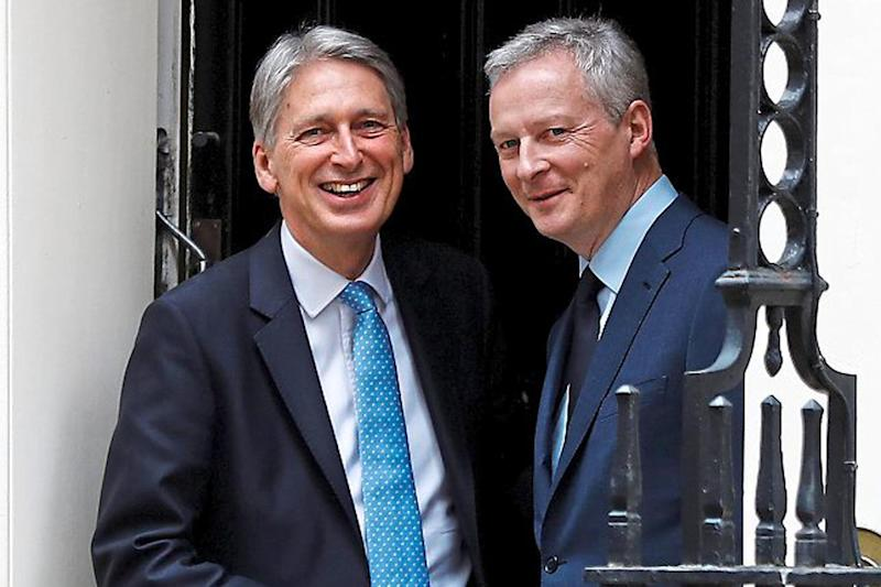 Showdown: Chancellor Philip Hammond meets France's Economy Minister Bruno Le Maire earlier this week: Reuters
