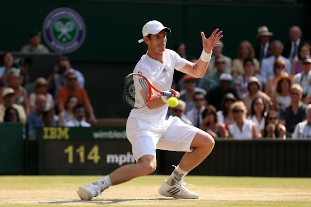 LONDON, ENGLAND - JULY 07: Andy Murray of Great Britain plays a forehand during the Gentlemen's Singles Final match against Novak Djokovic of Serbia on day thirteen of the Wimbledon Lawn Tennis Championships at the All England Lawn Tennis and Croquet Club on July 7, 2013 in London, England. (Photo by Clive Brunskill/Getty Images)